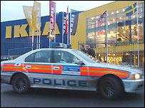 Police car outside closed Ikea store