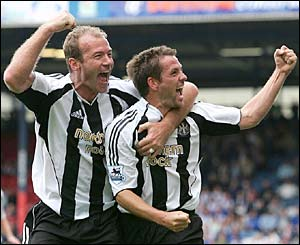 Newcastle's Alan Shearer and Michael Owen celebrate a goal