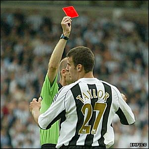 Newcastle's Steven Taylor is sent off by Mike Riley