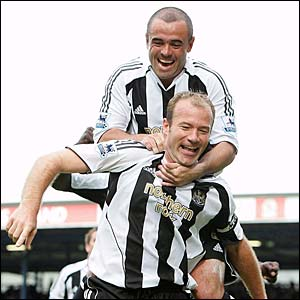 Newcastle's Stephen Carr congratulates Alan Shearer on his goal for Newcastle