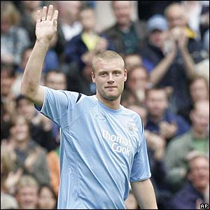 England cricketer Andrew Flintoff waves to the crowd at Manchester City v Bolton