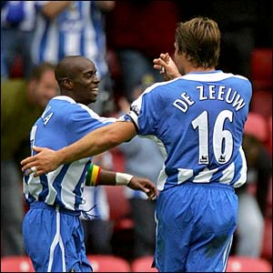 Wigna's Henri Camara and Arjan De Zeeuw celebrate scoring