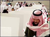 A Saudi man casts his vote in the first municipal election in Riyadh