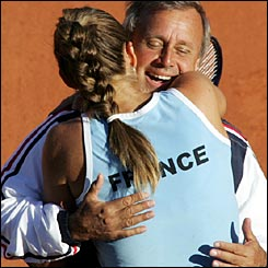 Mary Pierce hugs France captain Georges Goven