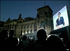 Crowds in Berlin watch a giant screen outside the Reichstag building