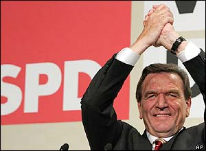 German Chancellor Gerhard Schroeder celebrates the SPD's strong showing