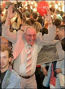 Left supporters celebrate