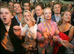 CDU supporters react as results of the official exit poll are announced