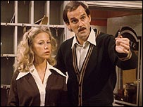 John Cleese and Connie Booth as Basil and Polly