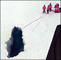 Members of the expedition try to reach the two men who fell into the crevasse (Picture: Chilean Air Force)