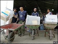 Election workers move ballot boxes in Kabul