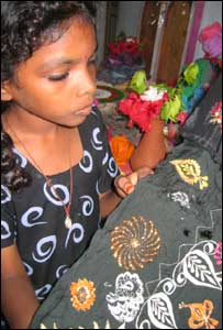 Girl learning embroidery