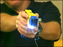 A Strathclyde officer holds out a Taser