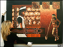 Charlotte Skene from the RMIT Gallery adjusts 'Assimilation Blues' by Aboriginal artist Sylvia Huege de Serville which tells the story of the Stolen Generation, Melbourne 15 December 2004.
