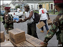 Army hand out food and water in Algiers, New Orleans
