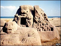 Three carved structures, including a granite lion, which were exposed by sands receding after the tsunami