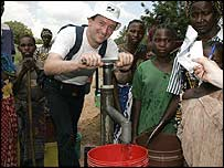 Andrew Cook trying out a WaterAid pump, Lugala, Tanzania