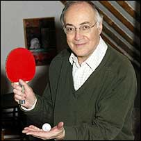 Michael Howard poses for a photograph in his attic