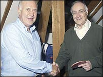 Mr Howard shakes hands with film-maker Michael Cockerell