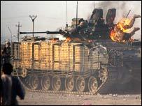 Soldier fleeing tank