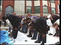 Muslim men worshipping outside the mosque in summer 2004