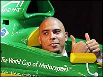 Ronaldo poses in the Brazil A1 car