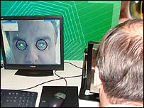 A member of the public being shown the biometric technology