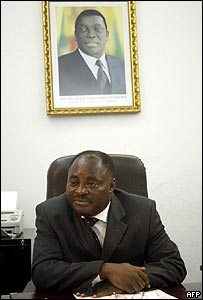 Togolese Communications Minister Pitang Tchalla under portrait of new leader Faure Gnassingbe