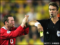 Wayne Rooney sarcastically applauds referee Kim Nielsen