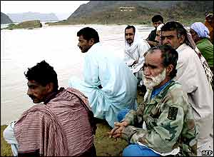 Villagers look at their flooded neighbourhood in Aghor, some 270km west of Karachi.