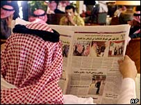 Saudi man reading a newspaper