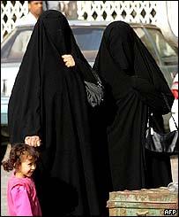Saudi women walk outside a polling station in Riyadh.
