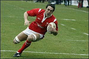 Jon Thomas scores the opening try for Wales
