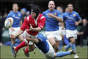 Hal Luscombe of Wales offloads a pass