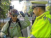 A police officer gives a cyclist safety advice in Edinburgh