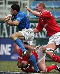 Centre Andrea Massi breaks forward for Italy