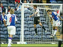 Newcastle striker Michael Owen scores against Blackburn last Sunday but there was a noticeable lack of fans at Ewood Park  for the game