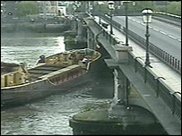 Barge which hit Battersea Bridge, is moved