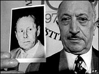 Simon Wiesenthal holds a picture allegedly of suspected Nazi war criminal Walter Rauff, in 1973