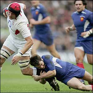 Ben Kay is tackled by France's Christophe Dominici