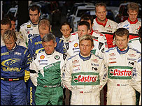 World rally drivers and co-drivers observe a one-minute silence