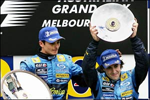 Alonso raises his trophy above his head in Melbourne
