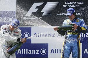 Alonso and Raikkonen spray champagne at Magny-Cours