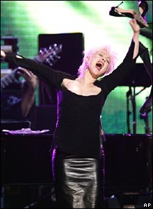 Cyndi Lauper takes off her shoes to dance while performing in New York.