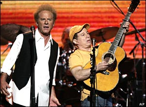 Art Garfunkel (left) and Paul Simon perform some of their hits of the 1960s and 1970s.