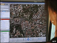 A woman looks at a view of the Italian capital Rome on Google Earth