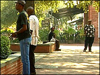 Unemployed men seeking labouring work in one of Savannah's public squares