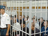 Defendants charged with terrorism sit in the supreme court of Uzbekistan in Tashkent, 20 September 2005