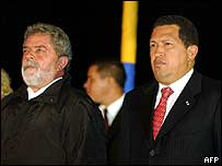 Luiz Inacio Lula da Silva (L) on arrival in Caracas with Hugo Chavez