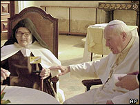 Sister Lucia with Pope John Paul II in Fatima, Portugal, in 2000